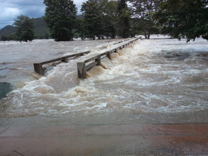 The Palamadu bridge is submerged at Hoggenkkal in Hanur taluk of Chamarajanagar district as water level in the River Cauvery increased on Thursday. DH Photo.