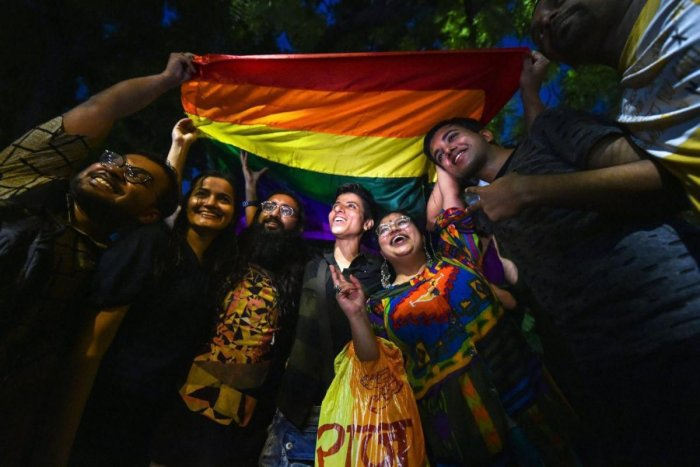 LGBTQ community members celebrate after the Supreme Court verdict which decriminalises consensual gay sex, in New Delhi, Thursday, Sept 06, 2018. A five-judge constitution bench of the Supreme Court unanimously decriminalised part of the 158-year-old colo