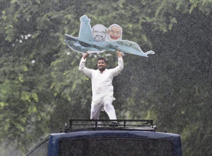 An Indian Youth Congress member carries a model of a plane during a protest over Rafale deal issue outside the AICC office in New Delhi, on Saturday, Sept. 22, 2018. (PTI Photo)