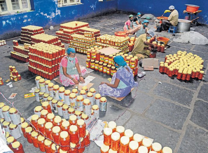 Enterprising Women packing pickle and cleaning chillies at the food-processing unit in Hudli village, Belagavi district. DH PHOTOS BY CHETHAN KULKARNI