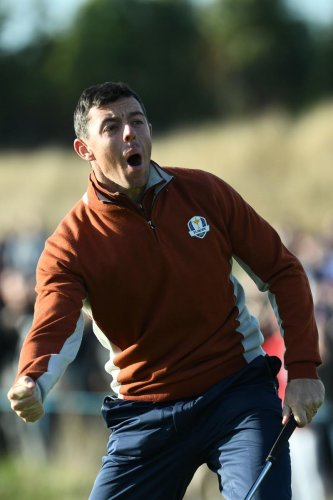 SOLID SHOW: Europe's Rory McIlroy celebrates after holing a putt during his fourball match on Saturday. AFP