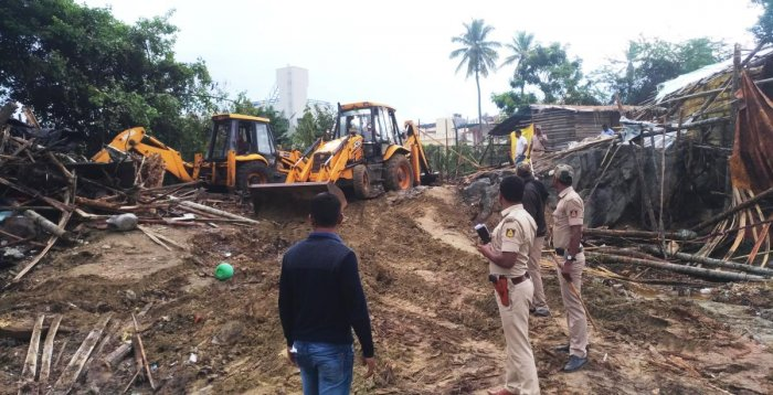 Illegally constructed huts being cleared at Idgah Nagar in Kadur.