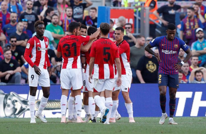 DELIGHTED Athletic Bilbao's players celebrate after Oscar de Marcos scored their first goal against Barcelona. REUTERS