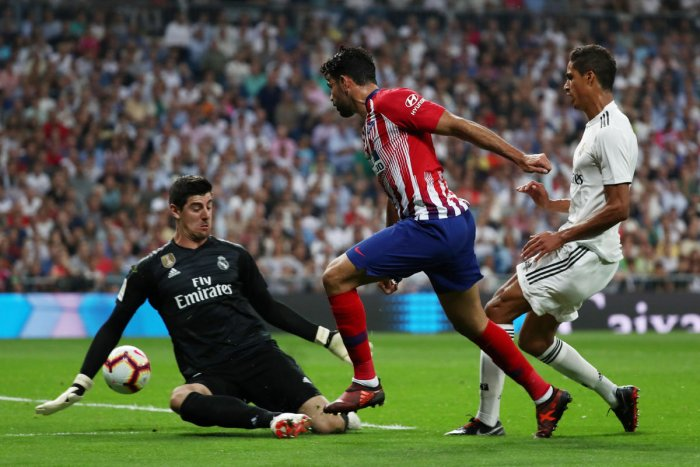 TOP NOTCH: Real Madrid's Thibaut Courtois (left) makes an exceptional save off against Atletico Madrid's Diego Costa during their La Liga clash on Saturday. REUTERS