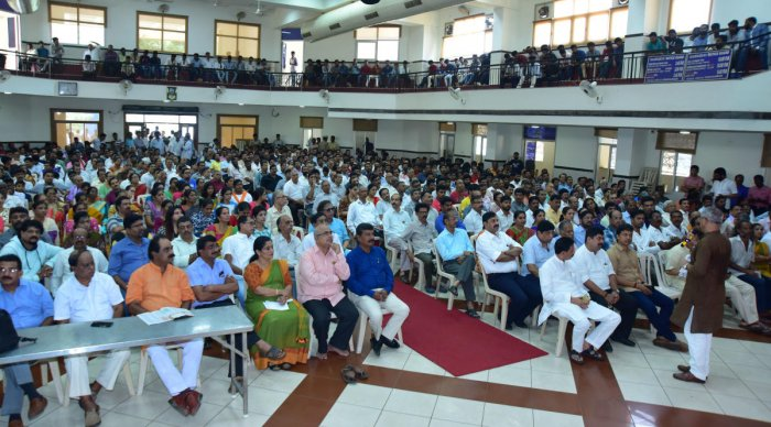 People and elected representatives participate in the screening of a 'Mann Ki Baat' programme at the T V Raman Pai Convention Centre in Mangaluru on Sunday.