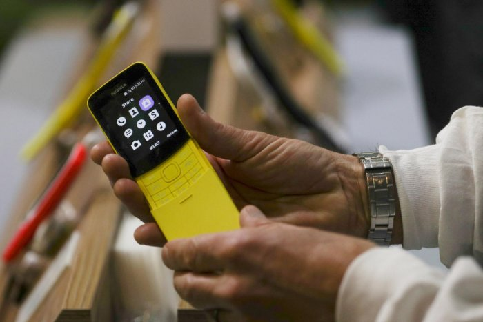 A man holds a Nokia 8110 4G device at the Mobile World Congress in Barcelona recently. REUTERS