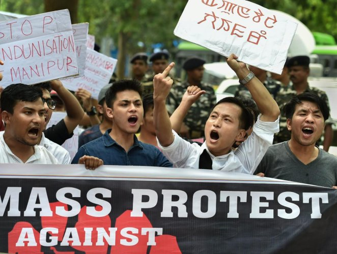 Manipur University Student's Union (MUSU) raise slogans demanding the removal of Vice Chancellor Adya Prasad Pandey, in New Delhi on Wednesday, July 18, 2018. (PTI Photo/Arun Sharma)