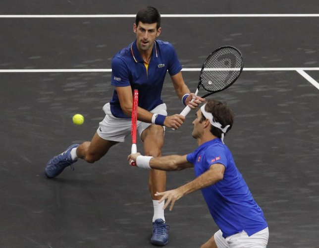 Novak Djokovic (left) and Roger Federer in action during the Laver's Cup.