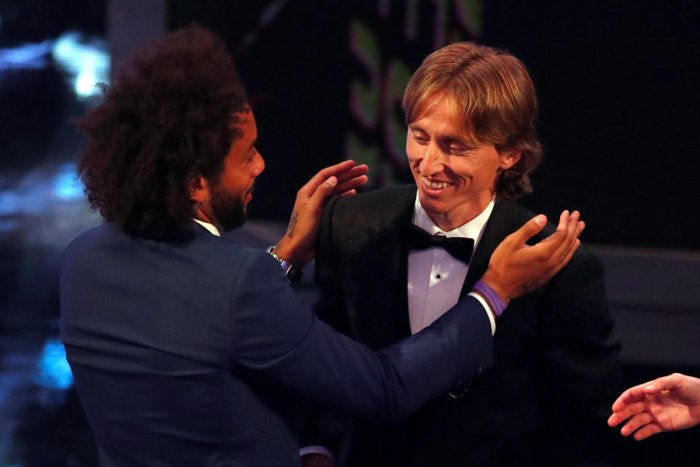 Real Madrid's Marcelo (left) congratulates his team-mate Luka Modric for winning the FIFA's best player of the year award. Reuters