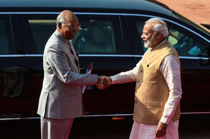 Prime Minister Narendra Modi shakes hands with India's President Ram Nath Kovind. (AFP Photo)