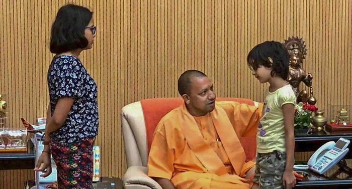 Uttar Pradesh Chief Minister Yogi Adityanath interacts with the children of the private company executive Vivek Tiwari, who was reportedly shot at by a police constable, in Lucknow on Monday. PTI