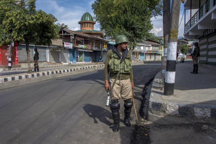 A security person stands guard during restrictions and strike call given by separatist leaders against, in Srinagar. (PTI File Photo)