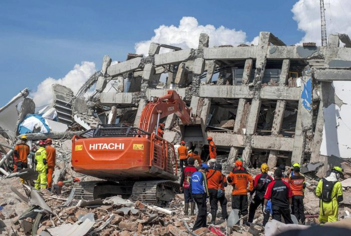 Rescuers search for the earthquake victims trapped in the collapsed Roa Roa Hotel in Palu, Central Sulawesi, Indonesia, Tuesday, Oct. 2, 2018. (AP/PTI)