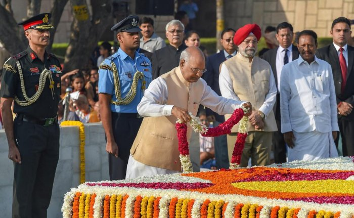 President Ram Nath Kovind pays homage to Mahatma Gandhi on his birth anniversary at Rajghat, in New Delhi, Tuesday, Oct 02, 2018. (PTI Photo)