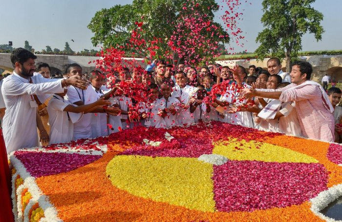 Students pay floral tribute to Mahatma Gandhi on the occasion of his 150th birth anniversary, at Rajghat in New Delhi on Tuesday. (PTI)