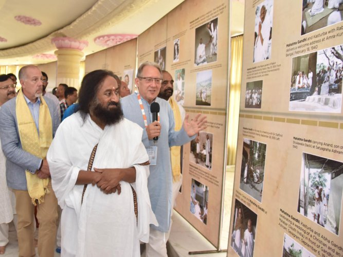 Art of Living founder Sri Ravi Shankar, Director of Strategic Studies, Police Foundation, USA, Frank Straub and Union Minister of State (MoS) Home Affairs Hansraj Ahir at the photo exhibition of Mahatma Gandhi as the part of 2nd day of CVE summit at Art o