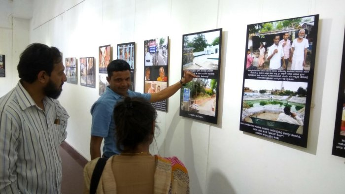 Sudhir Shetty speaks to visitors at the exhibition of his photos titled 'Hey Ayodhya' at Rangoli Art Center on MG Road Boulevard on Tuesday.