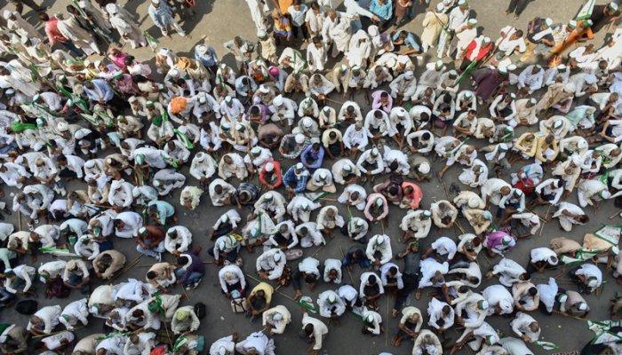 Farmers sit in protest at Delhi-UP border during 'Kisan Kranti Padyatra' in New Delhi. (PTI Photo)