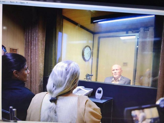 Former Indian Navy officer Kulbhushan Jadhav's wife and mother meet him while seated across a glass partition at the Pakistan Foreign Office in Islamabad. (PTI File Photo)