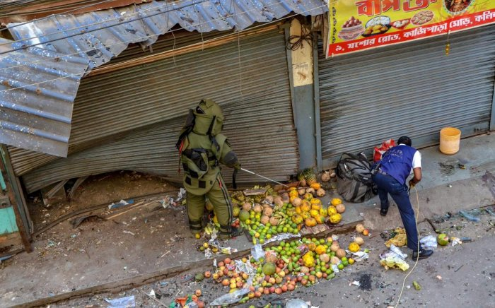 A bomb disposal squad member inspects the site of low intensity bomb blast at Kazipara, Nagerbazar area of Dumdum, in Kolkata, Tuesday, Oct 2, 2018. (PTI Photo)