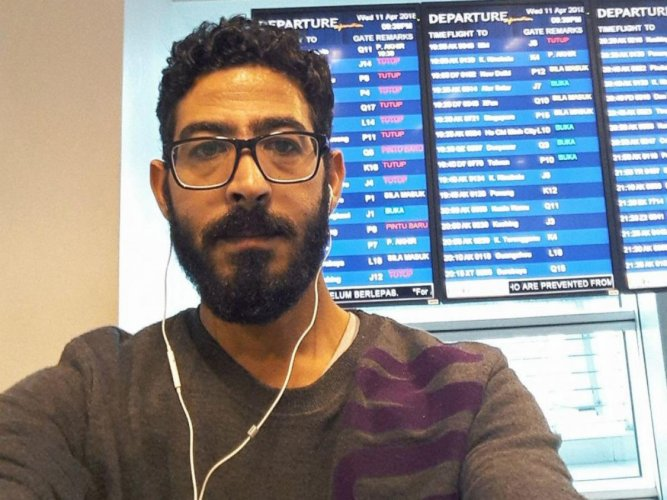 """Syrian refugee Hassan al-Kontar inside the Kuala Lumpur airport where he experienced a bizarre saga that drew comparisons with the hit movie """"The Terminal"""". Youtube"""