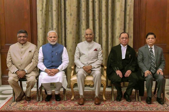 President Ram Nath Kovind flanked by newly sworn-in Chief Justice of India Justice Ranjan Gogoi (R) and Prime Minister Narendra Modi (L), after the oath taking ceremony, at Rashtrapati Bhawan, in New Delhi, Wednesday, Oct 3, 2018. Also seen are Union Law
