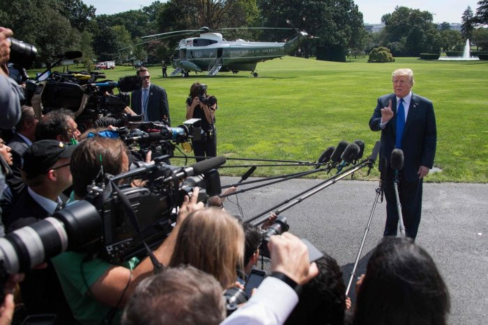 US President Donald Trump speaks as he departs the White House in Washington, DC, on October 2, 2018. (AFP Photo)