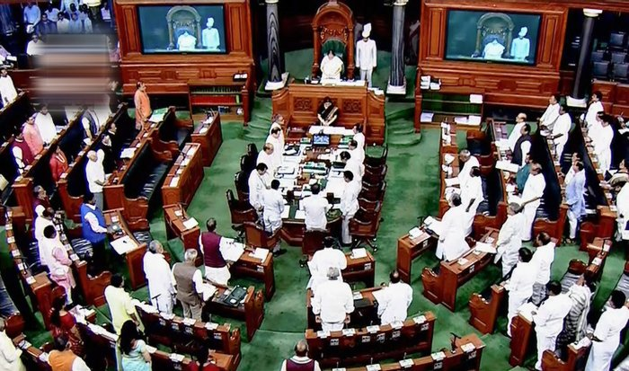 Parliamentarians observe silence during an obituary reference in the Lok Sabha during the Monsoon session of Parliament. Credit: PTI