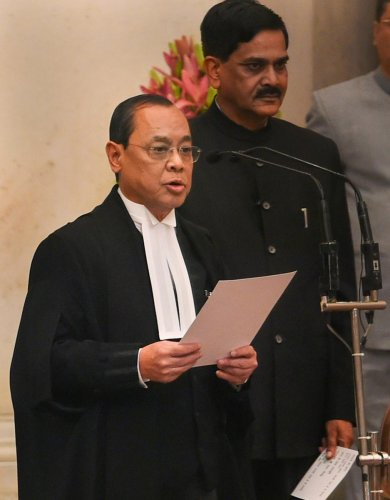Justice Ranjan Gogoi takes his oath of office after he was appointed as the 46th Chief Justice of India at Rashtrapati Bhawan in New Delhi. PTI