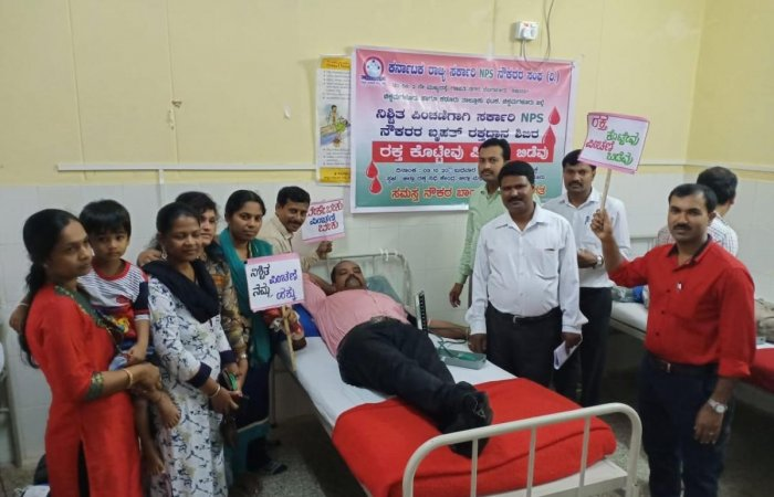 State Government Employees NPS Employees' Association donated blood at the district hospital on Wednesday as part of the protest.