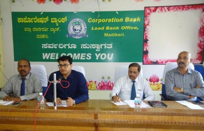 Zilla Panchayat CEO Prashanth Kumar Mishra chairs the district lead bank meeting in Madikeri on Wednesday.