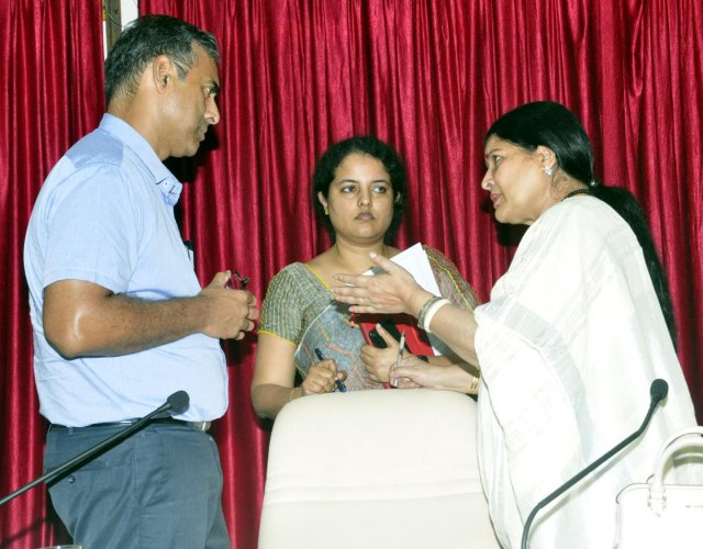 District In-charge Minister Jayamala (right) interacts with District In-charge Secretary Maheshwar Rao and Deputy Commissioner Priyanka Mary Francis after a KDP meeting in Udupi on Wednesday.