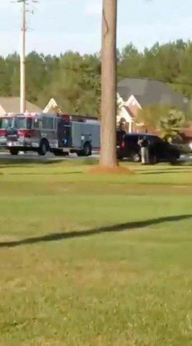 Emergency personnel are seen on site in the aftermath of a shooting in Florence, South Carolina, U.S. October 3, 2018, in this still image obtained from a social media video. (Derek Lowe/via REUTERS)