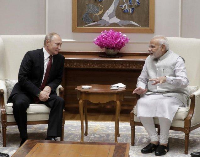 Russian President Vladimir Putin and Indian Prime Minister Narendra Modi meet in New Delhi. (PTI Photo)
