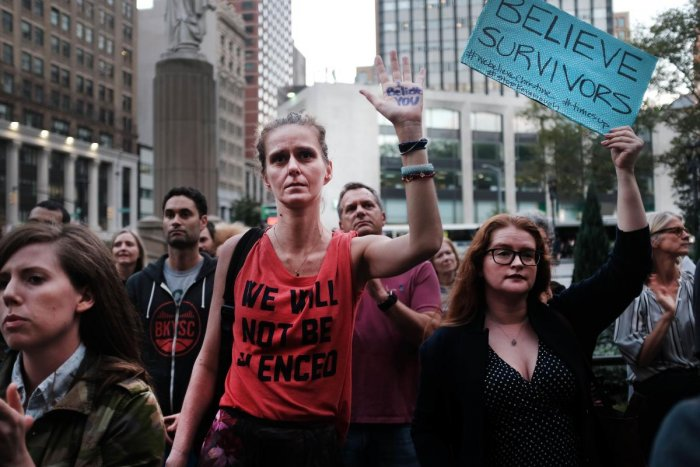 Women attend a rally and vigil in front of a Brooklyn courthouse calling to stop the nomination of Republican Supreme court candidate Judge Brett Kavanaugh in New York City on October 3, 2018. AFP