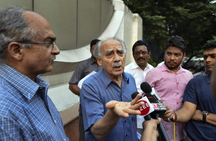 Former Union minister Arun Shourie addresses the media as advocate Prashant Bhushan looks on, after meeting CBI Director Alok Verma in relation to Rafale Deal at the CBI Headquarters in New Delhi on Thursday.