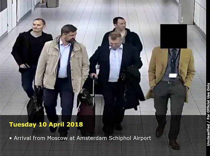This handout document released on October 4, 2018 by the Dutch Defence Ministry shows four men arriving from Moscow at the Amsterdam Schiphol Airport on April 10, 2018. AFP