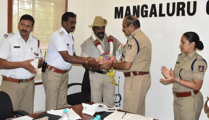 Moodbidri North subdivision head constable Vijay Kanchan being felicitated by City Police Commissioner T R Suresh for winning a silver medal in 105 kg category at the Asian Benchpress Championship held in Dubai recently.