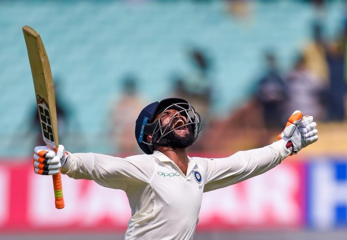 OVER THE MOON Ravindra Jadeja celebrates his century on the second day of the first Test against West Indies in Rajkot on Friday. PTI