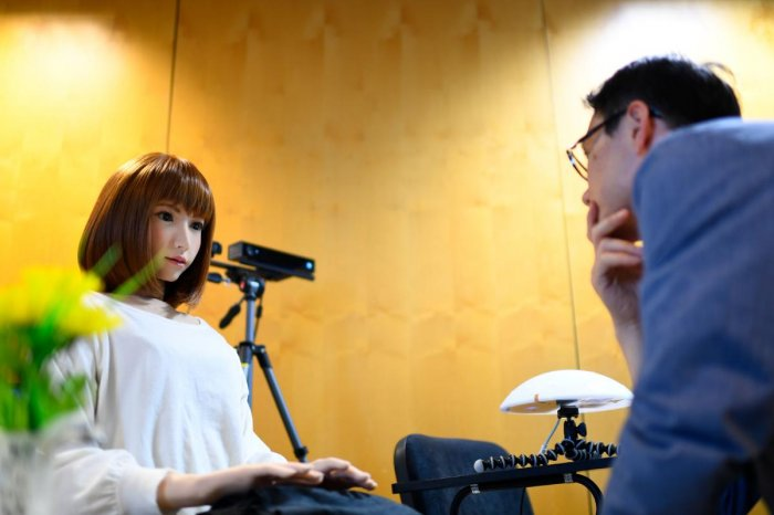 A robot created by Japan's Hiroshi Ishiguro Laboratories called Erica (left) is presented at the IROS 2018 International Conference on Intelligent Robots in Madrid on October 5, 2018. AFP
