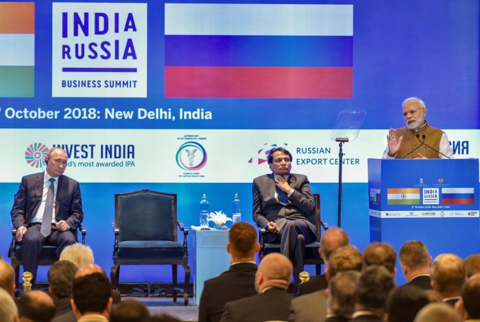 Prime Minister Narendra Modi addresses the India-Russia Business Summit as Russian president Vladimir Putin (L) and Union Commerce and Industry Minister Suresh Prabhu (C) look on, in New Delhi on Friday. PTI