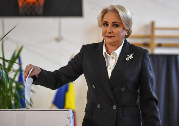"""Romanian Prime Minister Viorica Dancila casts her ballot in a referendum to change the constitutional definition of """"family"""", at a polling station in Bucharest on October 6, 2018. AFP"""