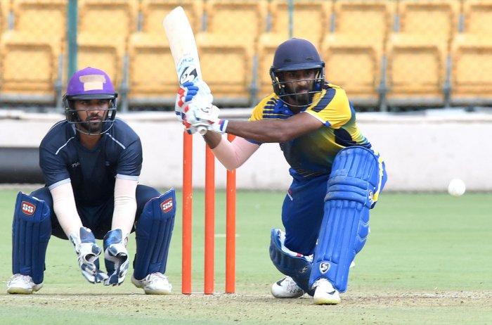 FINE KNOCK: Karnataka's R Samarth sweeps one en route to his 98 against Himachal Pradesh on Saturday. DH Photo/ Srikanta Sharma R