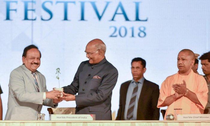 Union Environment Minister Harsh Vardhan felicitates President Ram Nath Kovind as Uttar Pradesh Chief Minister Yogi Adityanath looks on, at the India International Science Festival (IISF), in Lucknow on Saturday. PTI