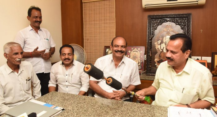 Union Minister D V Sadananda Gowda inspects an alternative whip, meant to be used in Kambala races, during a press meet in Mangaluru on Saturday.