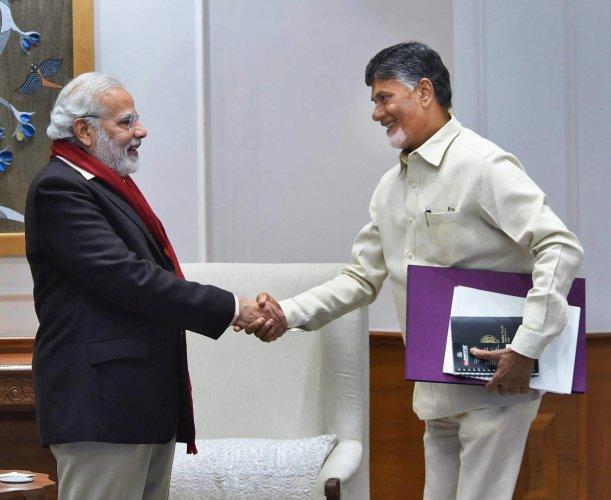Prime Minister Narendra Modi with TDP President and Andhra Pradesh Chief Minister N Chandrababu Naidu. (PTI file photo)