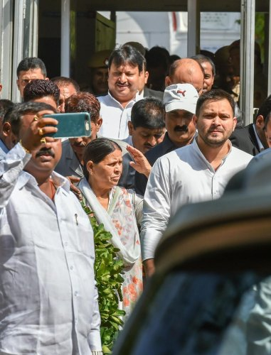 Former Bihar chief minister Rabri Devi with her son Tejashwi Prasad Yadav coming out from Patiala House court in (IRCTC) tender scam case, in New Delhi on Saturday. PTI