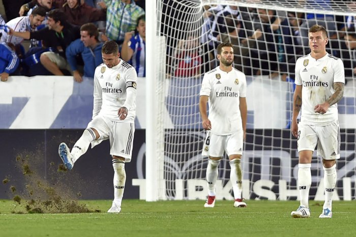 TERRIBLE TIMES: Real Madrid's (from left) captain Sergio Ramos, Nacho Fernandez and Toni Kroos wear a dejected look after suffering a shock defeat against Alaves on Saturday. AFP