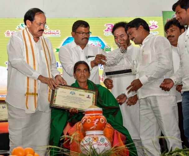 Vice President M. Venkaiah Naidu presents 'Rythu Nestham' awards, in Hyderabad. PTI