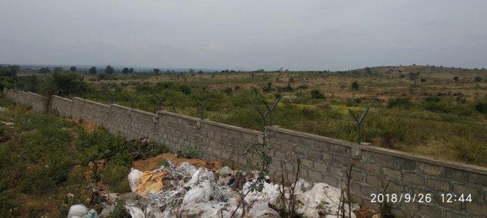The vacant lands, acquired for Wipro Limited and Shapoorji Pallonji Group, by KIADB under Mogarahalli and Anaganahalli limits, in Srirangapatna taluk.